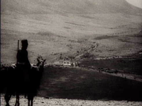 A horseman witnesses the massive undertaking that is the Bakhtiari migration from afar.