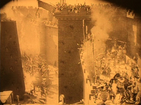 Persian Siege Towers approach the Walls of Babylon. This initial attack is repulsed by the Babylonians and their leader Belshazzar. The movie recounts, 'Cyrus moves upon Babylon; in his hand the sword of war, most potent weapon forged in the flames of intolerance.'