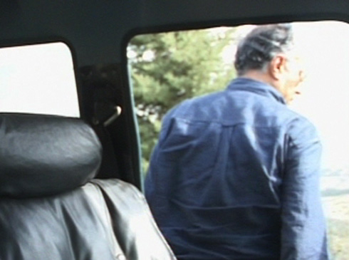Kiarostami exits his car to demonstrate the capabilities of digital filmmaking.
