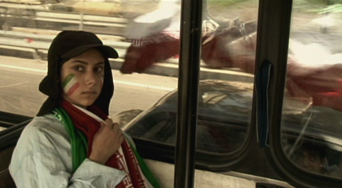 Sima Mobarak Shahi's character tries not to stand out on the bus ride to the stadium.