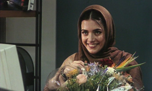 This office worker gladly accepts Abbas's flowers.
